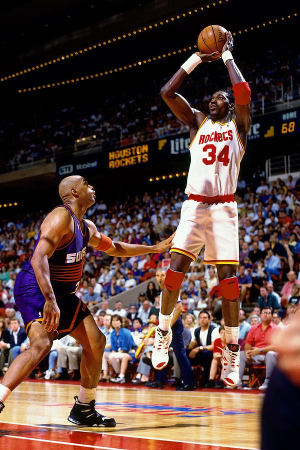 Hakeem Olajuwon shooting over Charles Barkley in the vintage NBA of the 1990's